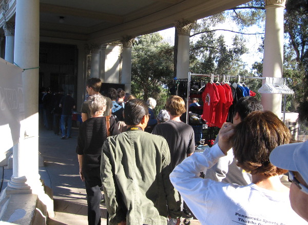People line up near gift shop to see and hear organ up close during the concert!