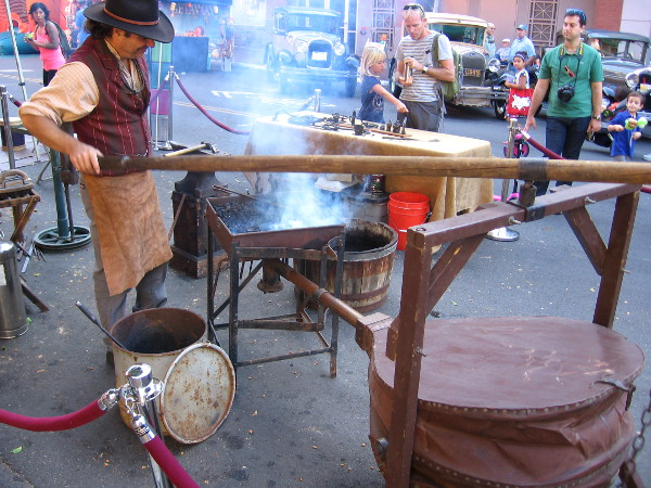 Blacksmith at Fall Back Festival in San Diego's Gaslamp works the bellows.