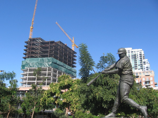 New Cisterra building rises behind Tony Gwynn statue at Petco Park in East Village.