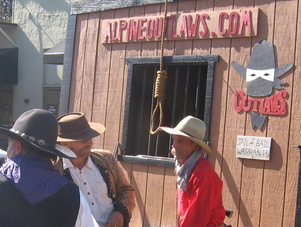 These cowboys, the Alpine Outlaws, have a jailhouse downtown and a hanging noose!