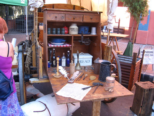 Wood cabinet at rear of wagon is packed with wares typical in 1880's.