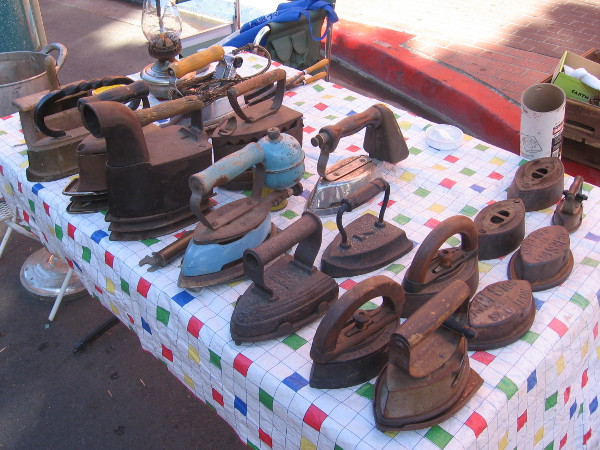 A table full of rusty irons from the Old West!