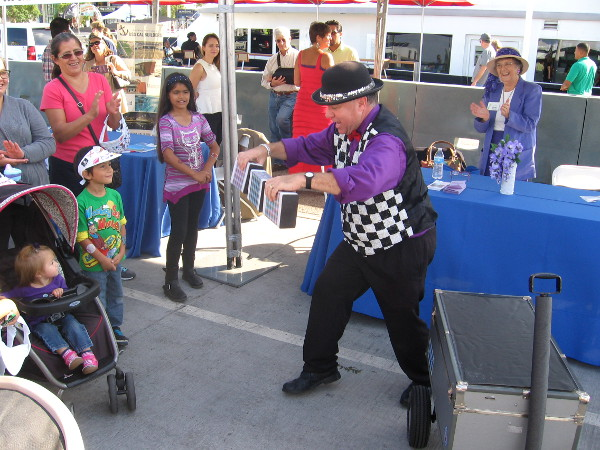 A crazy magician wowed young and old on the action-packed pier today.