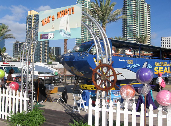 A kids fun zone featured a very cool Seal Tours amphibious vehicle.
