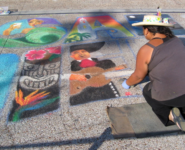 Chalk art created on the pier celebrates San Diego sights and tourism.