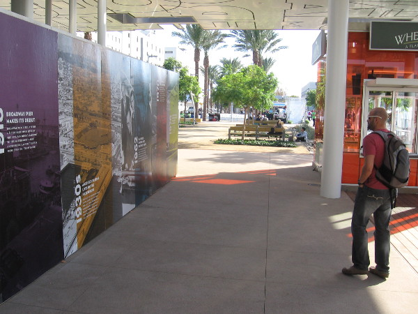 Mural around walls of a pavilion shows timeline of this bustling stretch of San Diego Bay.