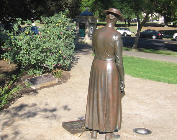 Bronze sculpture stands on footpath between Cabrillo Bridge and Sixth Avenue.