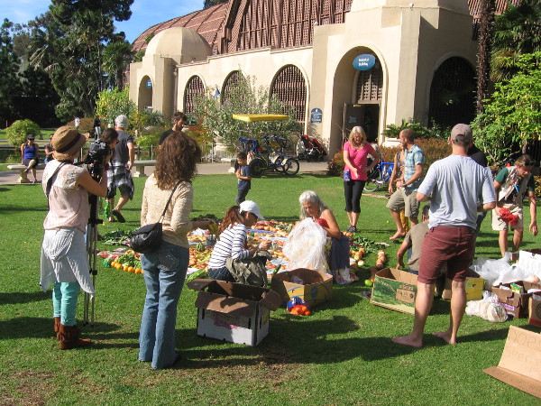 A crowd watches near the Botanical Building as the food creation nears completion.