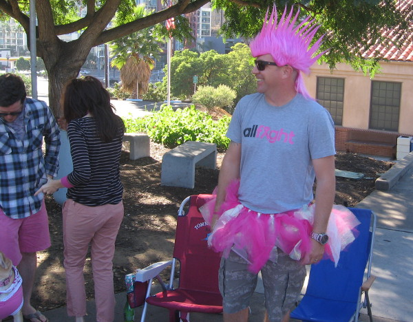 This cool bystander guy has a pink mohawk!