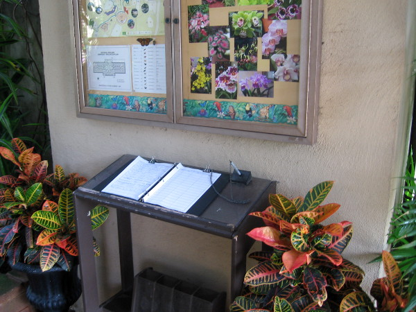 Information and guest book near entrance to historic Botanical Building.