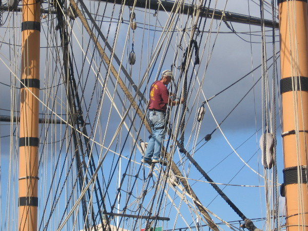 On the shrouds, in a tangle of ropes between masts.