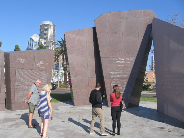 People stand on detailed map of where USS San Diego fought during World War II.