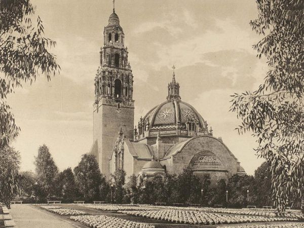 Spacious gardens near California State Building's landmark dome and bell tower during the Panama-California Exposition.