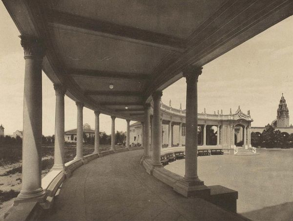 Organ Pavilion colonnade with California Bell Tower in distance. Trees and a large parking exist today on the left, behind the classic structure.