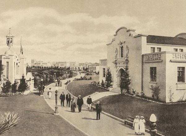 People take a stroll past a handful of state buildings at the Panama-California Exposition in Balboa Park.