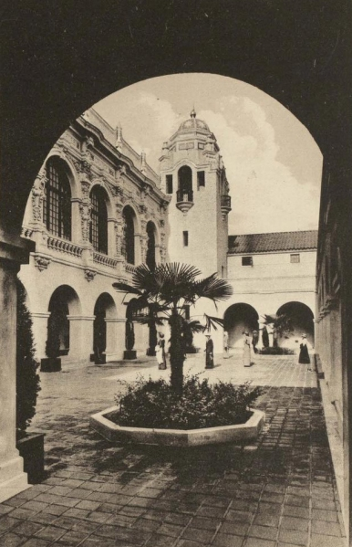 Visitors back in 1915 enjoy the Southern California Counties Building's elegant patio.