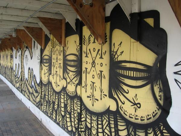 Construction fence street art along Cesar Chavez Parkway.