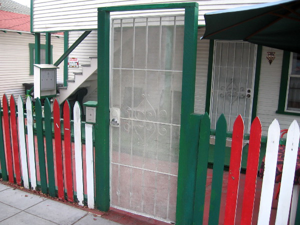 Colors of the Italian flag frame this unusual door on India Street.