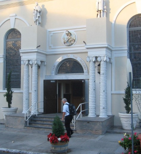 Walking past distinctive front of Our Lady of the Rosary church in Little Italy.