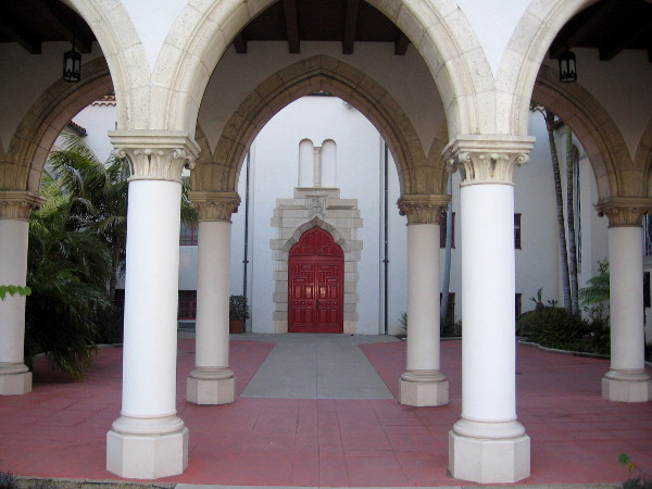 St. Paul's Cathedral in Bankers Hill and an elegant red door behind rows of columns.