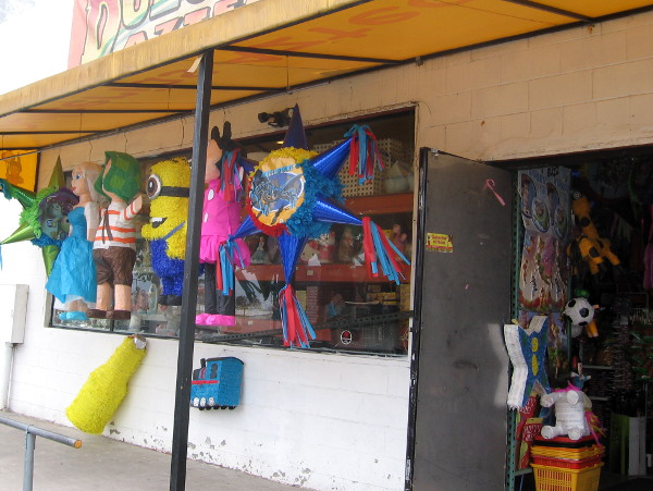 A little shop in Sherman Heights has a plain door invitingly open beside fun pinatas.