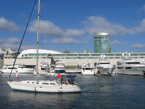 A bunch of beautiful yachts in a row behind the San Diego Convention Center.