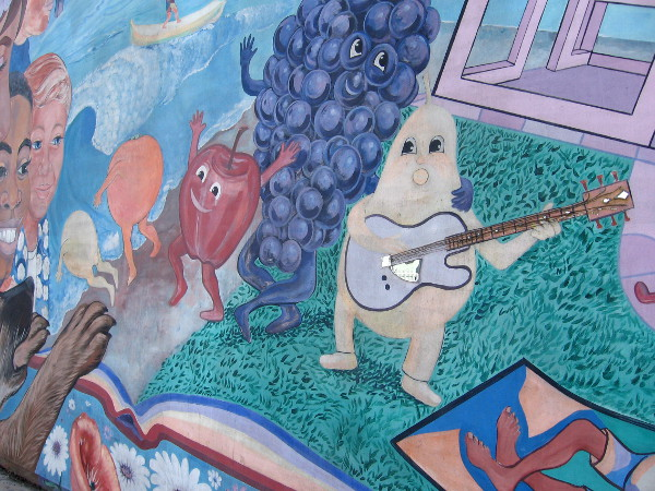 These animated fruit are goofing around in this fun Barrio Logan street mural.