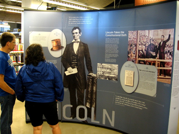 People at San Diego's new downtown public library check out a provocative historical exhibit.