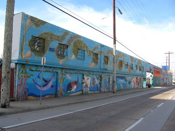 Long wall along Harbor Drive is the canvas for this very large street mural.