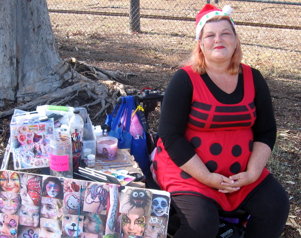 Is this face painter by the Balboa Park carousel Mrs. Claus or a ladybug.