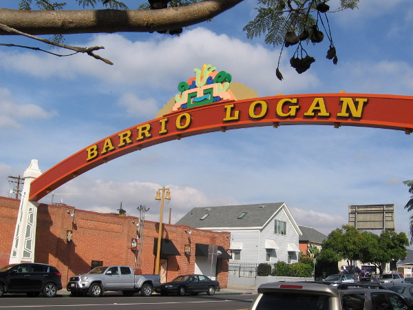 The colorful new Barrio Logan gateway sign arches over Cesar Chavez Parkway.