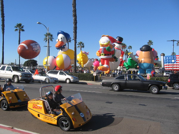 Tourists pass staging area for San Diego's 2014 Big Bay Balloon Parade.