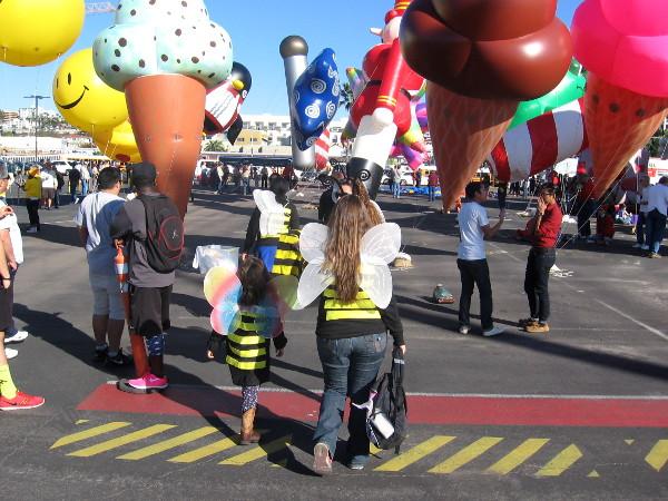 Costumed San Diegans enter a fantastic world of huge smileys and ice cream cones.