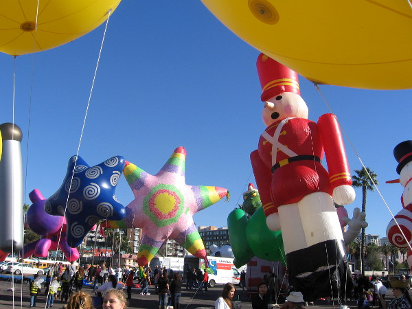 A giant traditional Christmas nutcracker tips a bit in the sea breeze.