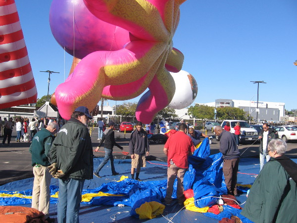 Preparation for the parade includes unrolling something wrinkly near an octopus.