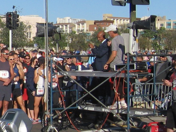 Elite long-distance runner Meb Keflezighi speaks to 5K race participants.