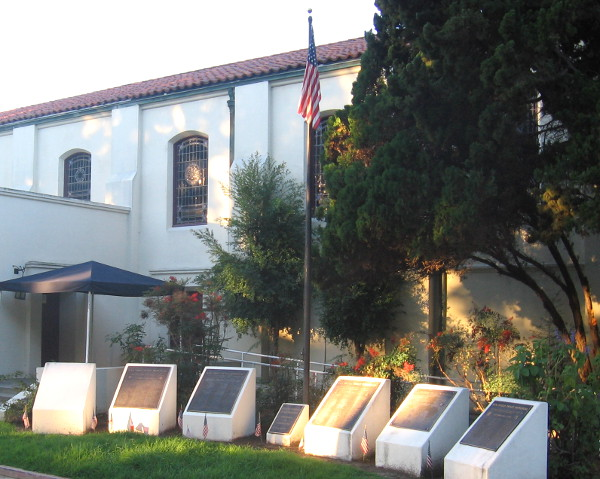 Morning light shines on plaques originally called the San Diego Peace Memorial.