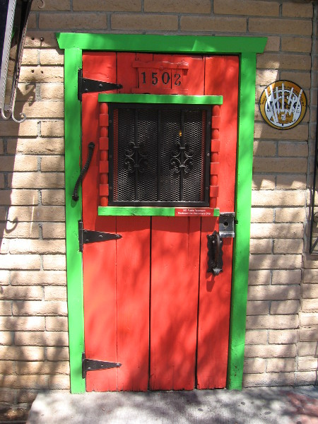 Just a cheerful orange and bright green door in East Village!
