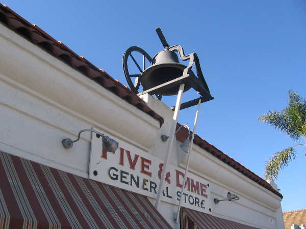 An old church bell is mounted on the roof of Old Town's Five and Dime General Store.