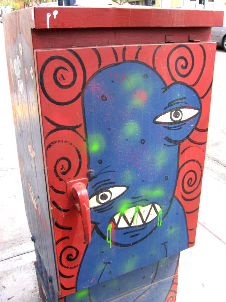 Crazy street art on a downtown utility box.