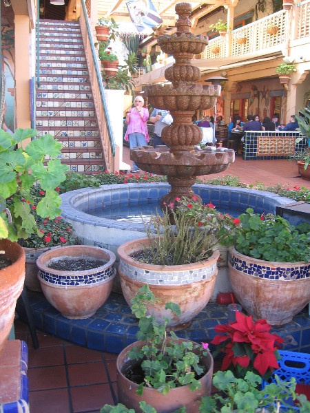 Fountain and splash of color in courtyard of an Old Town restaurant.