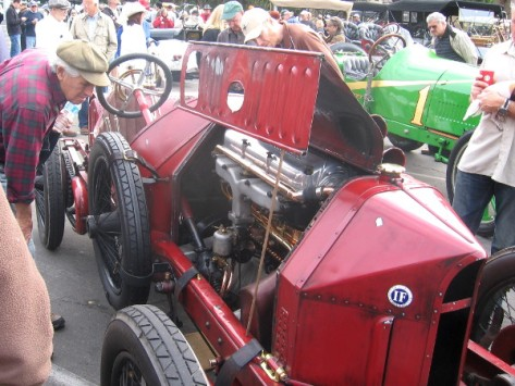 And here's a guy checking out the engine of an Italian Isotta Fraschini.