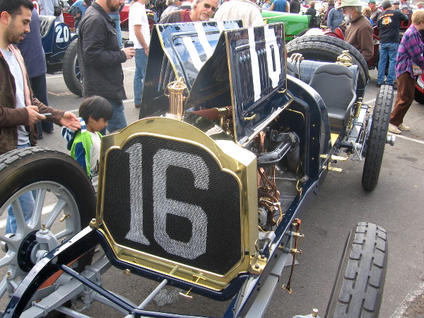 Kid checks out a 1912 Packard race car in Balboa Park.