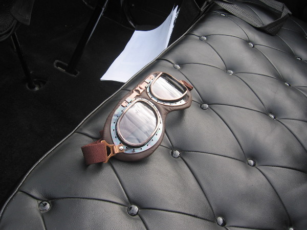 Racing goggles lie ready on leather seat. The road rally will begin in a few minutes!