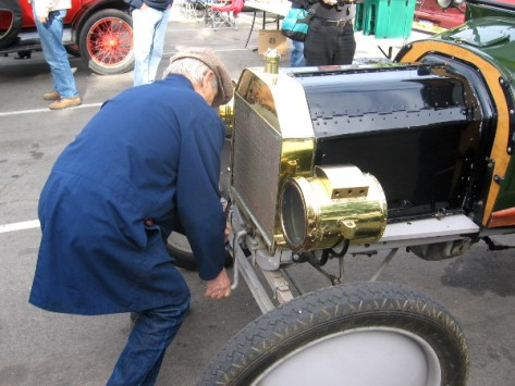 Getting the engine started with the old hand crank!