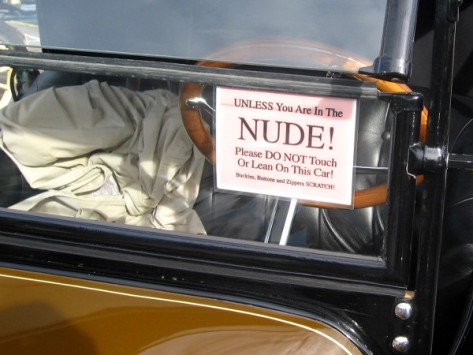 Don't touch this fancy car unless you are nude! (And showered, presumably.)