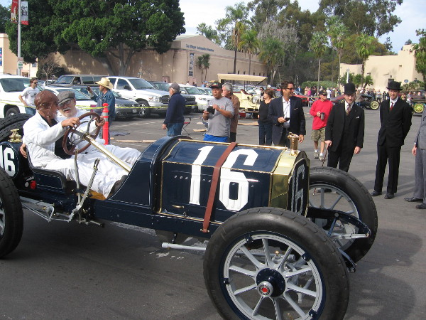 Many drivers and onlookers wore clothing styles from early 20th century.