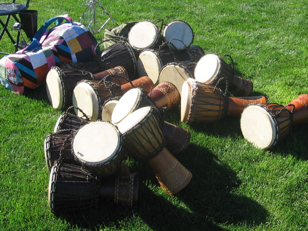 A big pile of drums wait to make music in the waterfront park!