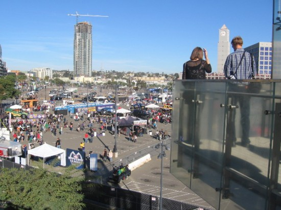 People gaze down at Monster Jam's Party in the Pits in the Petco stadium parking lot.