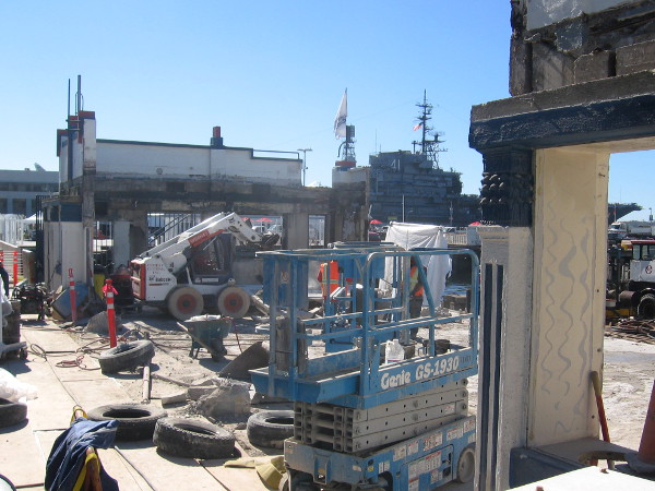 Demolition of the old waterfront cafe and harbor tour embarkation hub is underway.